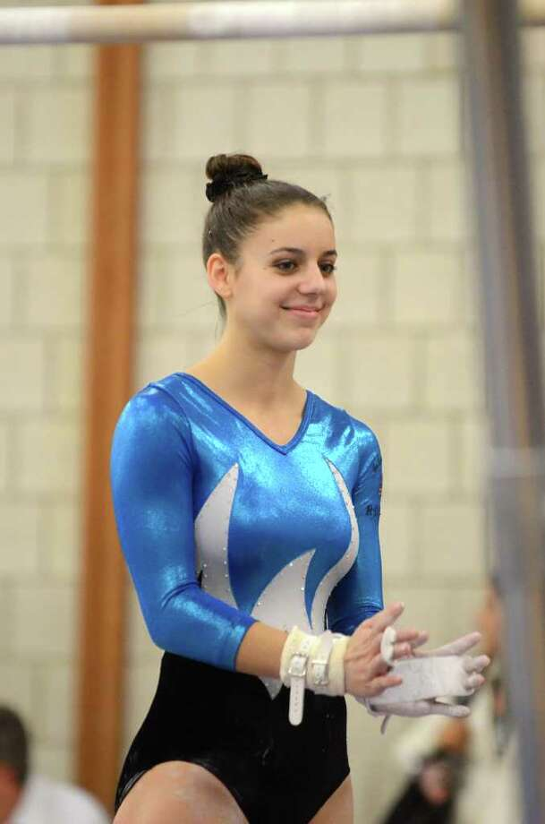 Staples' Anna Violette, in action earlier this year, had an all-around score of 33.2 in leading the Lady Wreckers to a team-high 131.7 Tuesday in a loss at Pomperaug. Photo: Amy Mortensen, Amy Mortensen / For The Westport News / Connecticut Post Freelance