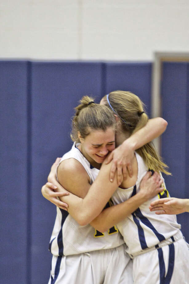 Weston's Ellie Martin and Lianna Hursh hug after beating Wilton Dec. 27. Martin had 21 points and Hursh scored seven in a 53-30 win over Bethel Tuesday (Jan. 10). Photo: Johnathon Henninger, Johnathon Henninger / For The Westport News / Connecticut Post Freelance