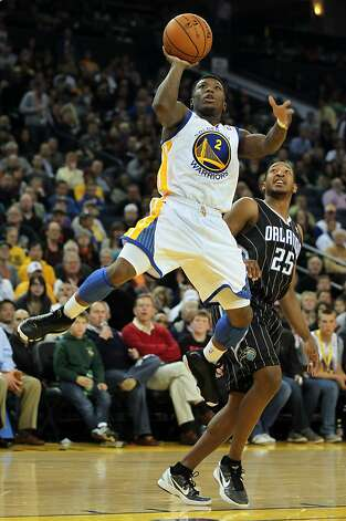Golden State Warriors' Nate Robinson scores two points in the first half of their NBA basketball game against the Orlando Magic Thursday, Jan. 12, 2012, in Oakland, Calif. Photo: Lance Iversen, The Chronicle