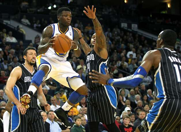 Golden State Warriors' Nate Robinson drives to the basket in the first half of their NBA basketball game against the Orlando Magic Thursday, Jan. 12, 2012, in Oakland, Calif. Photo: Lance Iversen, The Chronicle