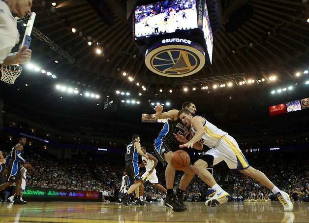 Golden State Warriors' Davis Lee breaks to the basket in the first half of their NBA basketball game against the Orlando Magic Thursday, Jan. 12, 2012, in Oakland, Calif. Photo: Lance Iversen, The Chronicle