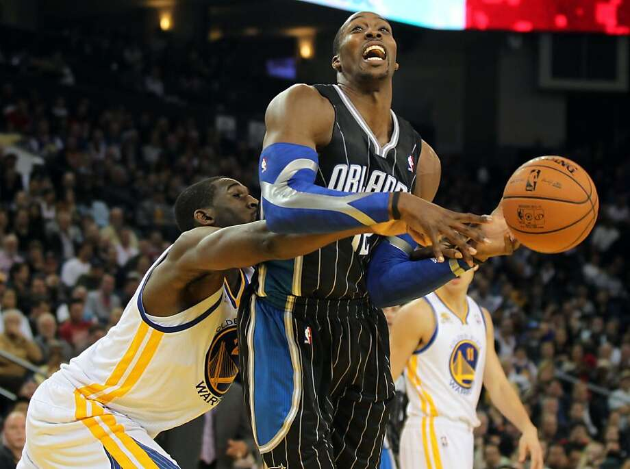 Orlando Magic Dwight Howard is fouled by Golden State Warriors' Ekpe Udoh late into the second half in their NBA basketball game Thursday, Jan. 12, 2012, in Oakland, Calif. Photo: Lance Iversen, The Chronicle