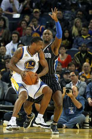 Golden State Warriors' Dominic McGuire works into the key looking to pass off in the second half of their NBA basketball game against the Orlando Magic Thursday, Jan. 12, 2012, in Oakland, Calif. Photo: Lance Iversen, The Chronicle