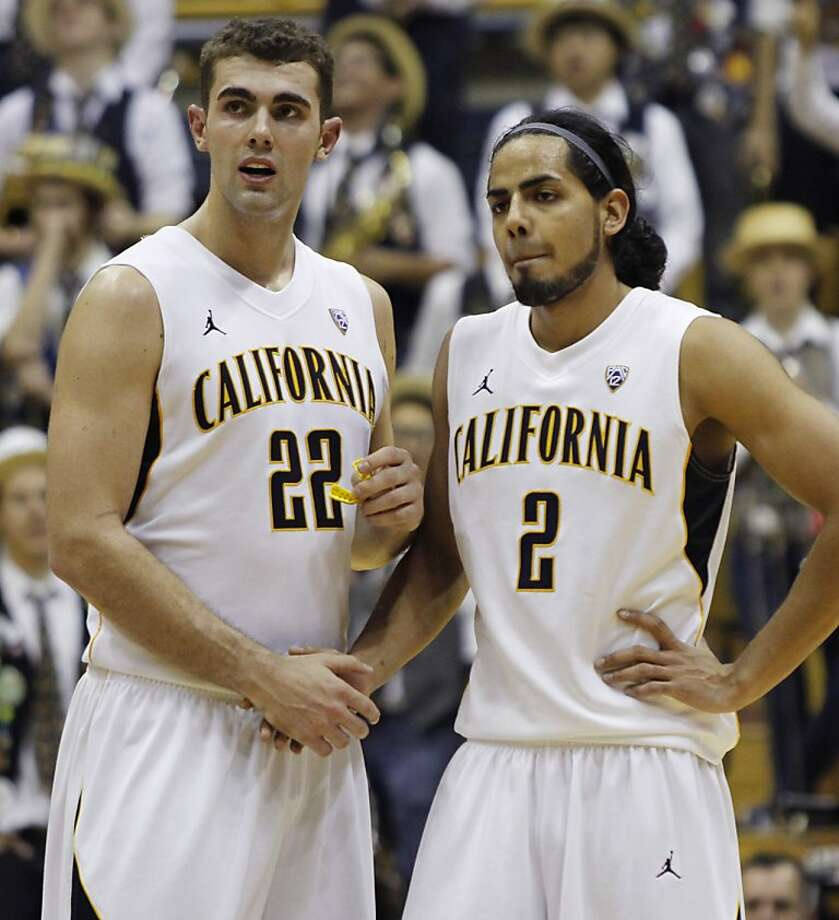 California's Harper Kamp (22) shakes hands with teammate Jorge Gutierrez near the end of an NCAA college basketball game against Colorado, Thursday, Jan. 12, 2012 in Berkeley, Calif. California beat Colorado 57-50. (AP Photo/George Nikitin) Photo: George Nikitin, Associated Press
