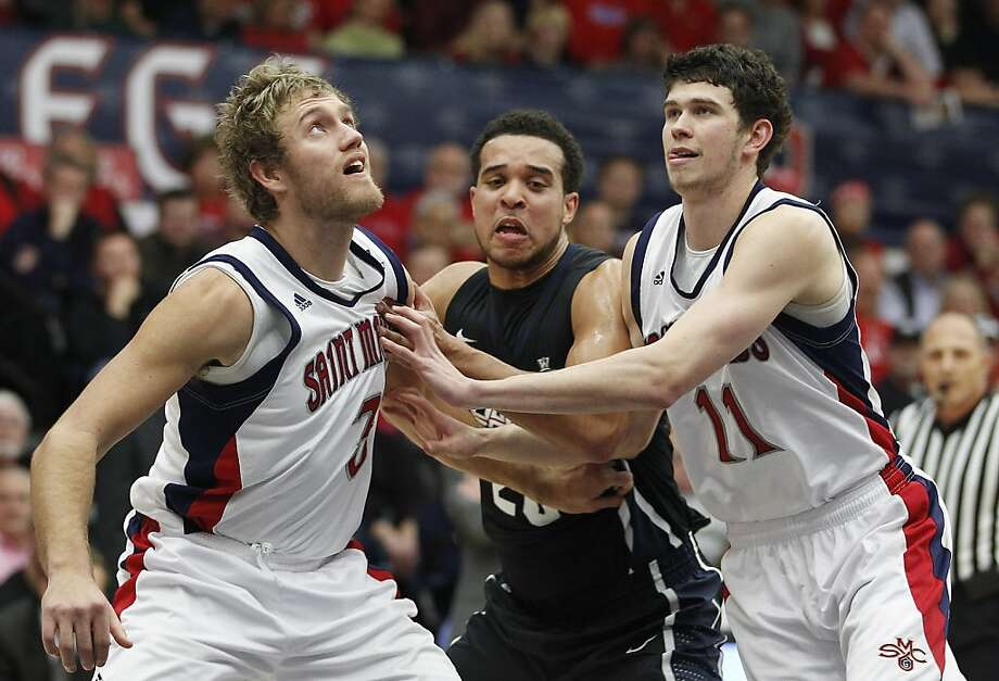 Gonzaga forward Elias Harris (20) looks for room between St. Mary's forwards Mitchell Young (3) and Clint Steindl (11) in the first half of an NCAA college basketball game on Thursday, Jan. 12, 2012, in Moraga, Calif. (AP Photo/Tony Avelar) Photo: Tony Avelar, Associated Press