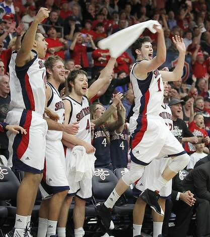 St. Mary's Clint Steindl (11), Matthew Dellavedova (4), Mitchell Young, and Brad Waldow, left, celebrate after beating Gonzaga 83-62 in an NCAA college basketball game on Thursday, Jan. 12, 2012, in Moraga, Calif. (AP Photo/ Tony Avelar) Photo: Tony Avelar, Associated Press