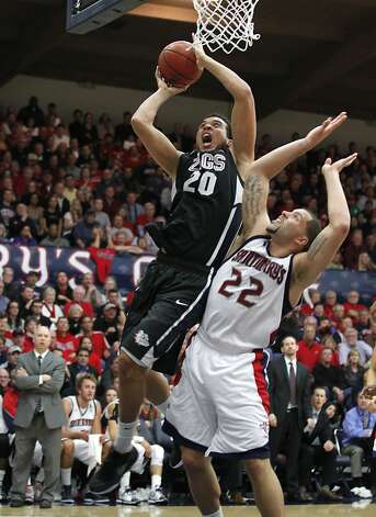 Gonzaga forward Elias Harris (20) shoots over St. Mary's forward Rob Jones (22) in the first half of an NCAA college basketball game Thursday, Jan. 12, 2012, in Moraga, Calif. (AP Photo/Tony Avelar) Photo: Tony Avelar, Associated Press
