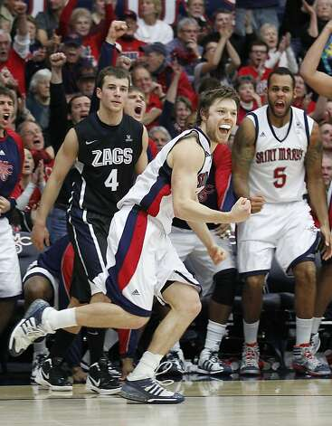 St. Mary's guard Matthew Dellavedova (4) celebrates after making a 3 point shot as Gonzaga's guard Kevin Pangos (4) looks on in the second half of an NCAA college basketball game on Thursday, Jan. 12, 2012, in Moraga, Calif. St. Mary's defeated Gonzaga 83-62. (AP Photo/ Tony Avelar) Photo: Tony Avelar, Associated Press