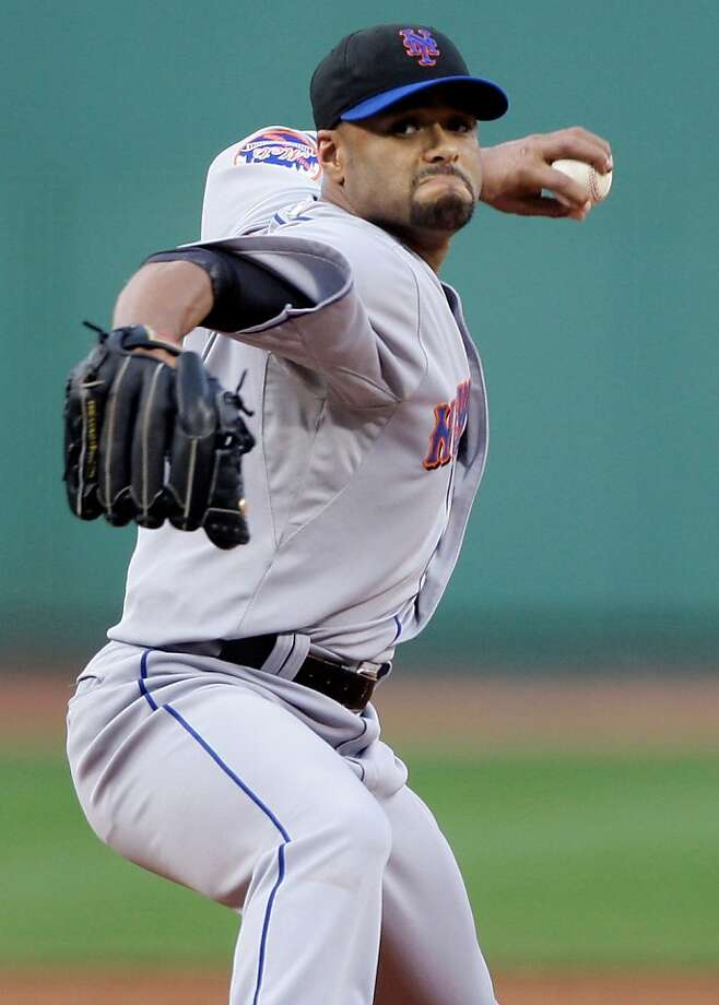 New York Mets starter Johan Santana delivers in the first inning against the Boston Red Sox in a baseball game in Boston, Friday May 22, 2009. (AP Photo/Charles Krupa) Photo: Charles Krupa, AP