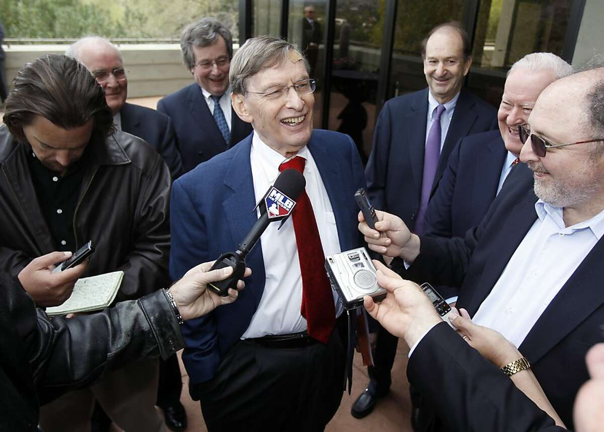 Commissioner Bud Selig, center, answers reporters' questions following a meeting with team owners, Thursday, Jan. 12, 2012, in Paradise Valley, Ariz. Selig has been given a two-year contract extension through the 2014 season. (AP Photo/Paul Connors)