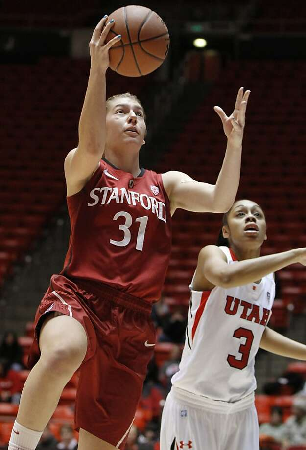 Stanford guard Toni Kokenis (31) drives past Utah guard Iwalani Rodrigues (3) during the first half of an NCAA women's college basketball game, Thursday, Jan. 12, 2012, in Salt Lake City. Photo: Jim Urquhart, Associated Press