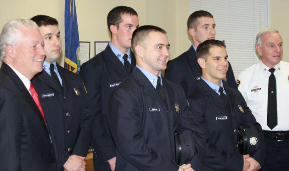 Fairfield First Selectman Michael Tetreau, far left, and Fire Chief Richard Felner, far right, flank newly sworn in firefighters Thursday. From left, they are: Scott Iannucci, Thomas Keneally, Francis Zwierlein III, Jordan Charney and Jason Salvato. Photo: Fairfield Fire Department / Fairfield Citizen contributed