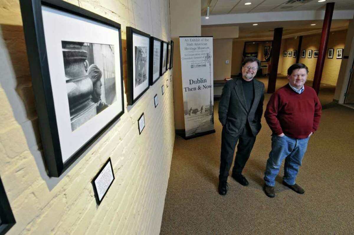 Ed Collins, left, and Jeff Cleary, right, stand near an exhibit of photographs from Dublin, Ireland from 40 years ago, along with contemporary photographs of the city, at the Irish American Heritage Museum on Thursday Jan. 5, 2012 in Albany, NY. Collins is Chair of the Board of Trustees of the museum, and Cleary is Executive Director. The museum will open on Jan. 17, 2012. (Philip Kamrass / Times Union )