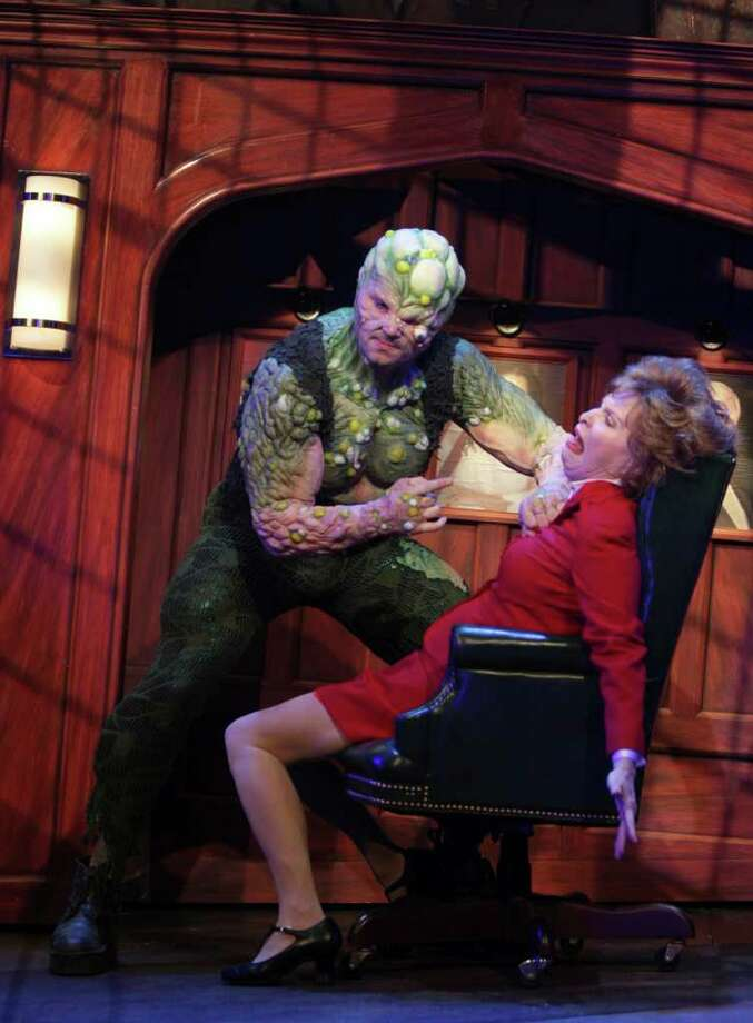 The Toxic Avenger (Constantine Maroulis) confronts Mayor Babs (Nancy Opel) in the touring production of The Toxic Avenger, which plays through Feb. 12 at the Alley Theatre. Photo: Nick De La Torre / c Houston Chronicle