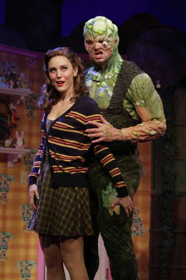 The Toxic Avenger, Constantine Maroulis, right, and his love interest Sarah the blind librarian, Mara Davi, during a dress rehearsal of the Toxic Avenger Tuesday, Jan. 10, 2012, in Houston. The Toxic Avenger will start January 13 and run until February 12. ( Nick de la Torre / Chronicle ) Photo: Nick De La Torre / c Houston Chronicle