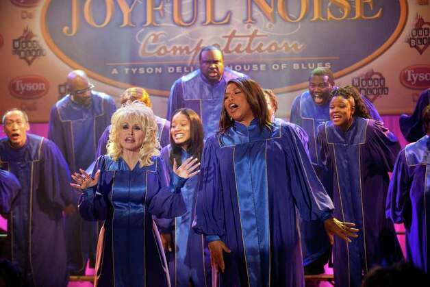"(Front l-r) DOLLY PARTON as G.G. Sparrow, KEKE PALMER as Olivia Hill and QUEEN LATIFAH as Vi Rose Hill in Alcon Entertainment's ""JOYFUL NOISE,"" a Warner Bros. Pictures release. Photo: Van Redin / HC"