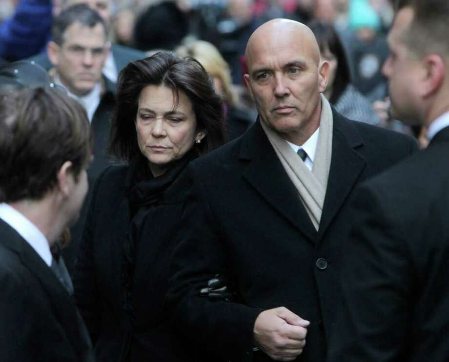 Madonna Badger, left, and Michael Borcina, a friend, arrive for the funeral of Badger's three children in New York, Thursday, Jan. 5, 2012. Photo: Seth Wenig, Associated Press / AP2011