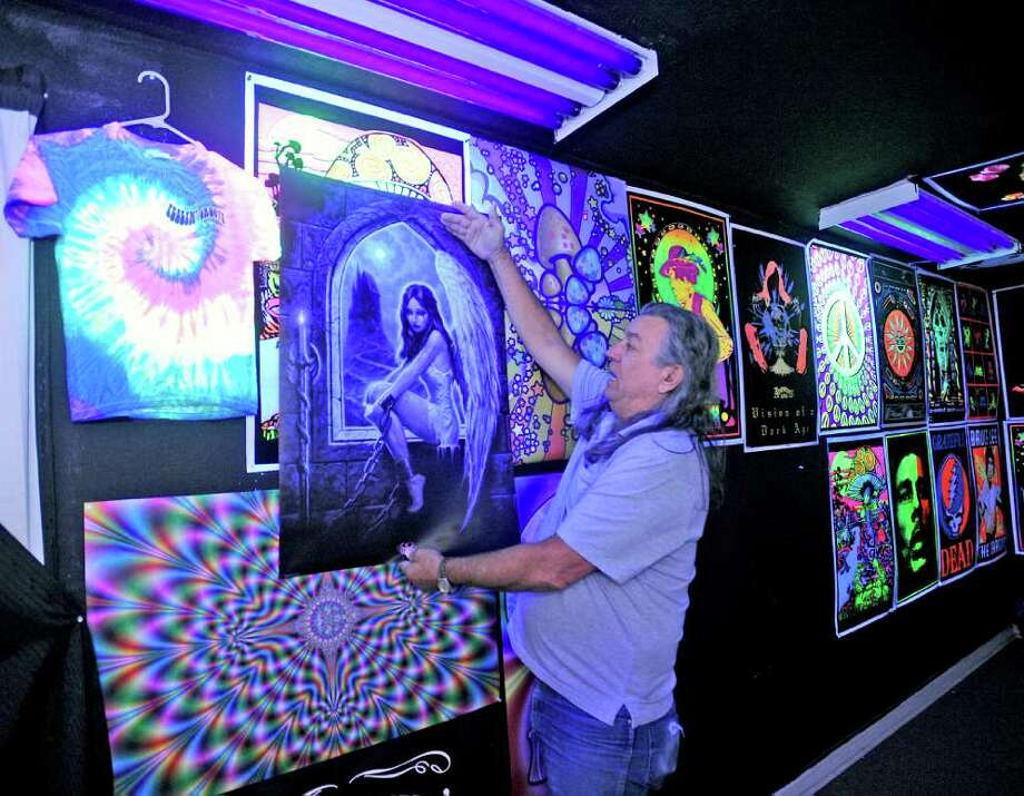 Melvin Brevell pulls down another blacklight poster,  that he no longer had stock till he reordered from his supplier, for a customer. He will welcome you to the 60s store when you walk in and hand you a set of 3-D glasses before entering the room.   Dave Ryan/The Enterprise