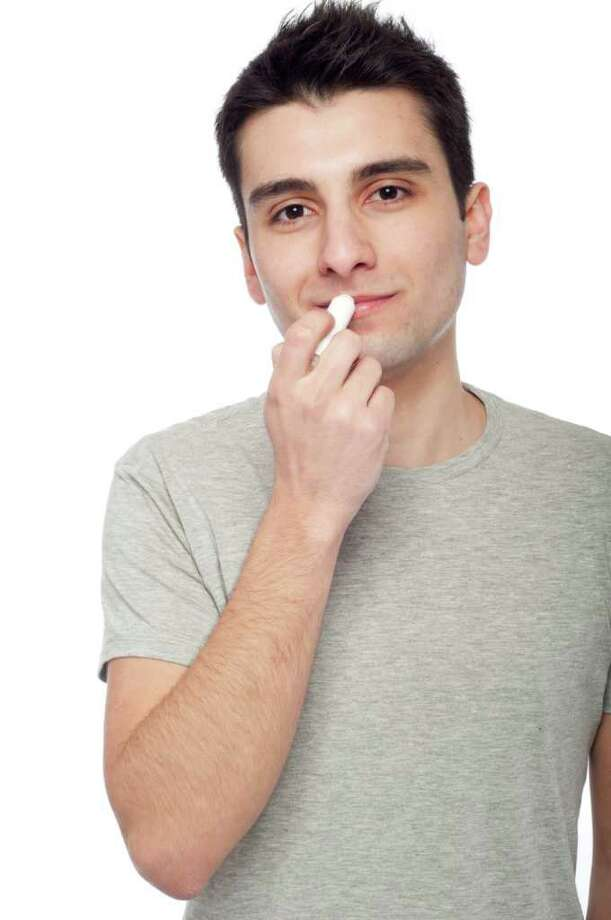 Dry air can damage your lips in winter, so bring on the balm. (Fotolia.com) / Luis Santos - Fotolia