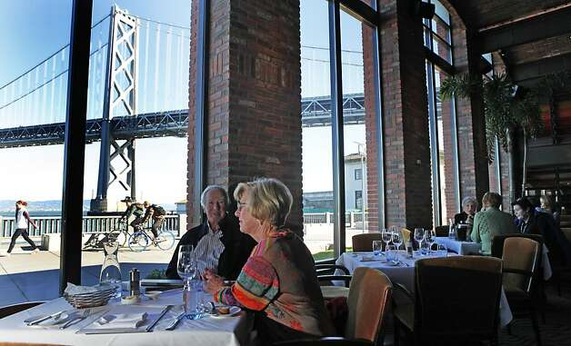 John and Judy Maller of Pebble Beach look out onto the Bay Bridge from the Waterbar on the Embarcadero. Photo: Lance Iversen, The Chronicle