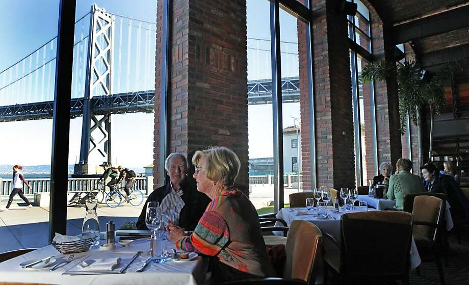 John and Judy Maller from Pebble Beach CA enjoy the views from the Waterbar restaurant on San Francisco's Embarcadero Thursday, Jan. 20, 2011. Photo: Lance Iversen, The Chronicle