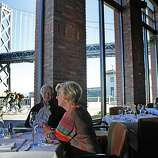 John and Judy Maller of Pebble Beach look out onto the Bay Bridge from the Waterbar on the Embarcadero.