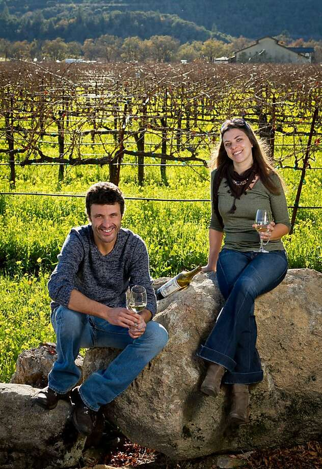 Letizia Pauletto and Enrico Bertoz of Arbe Garbe Winery with their wine in a vineyard next to their home in Rutherford, Calif., on Friday, December 16th,  2011. Photo: John Storey, Special To The Chronicle