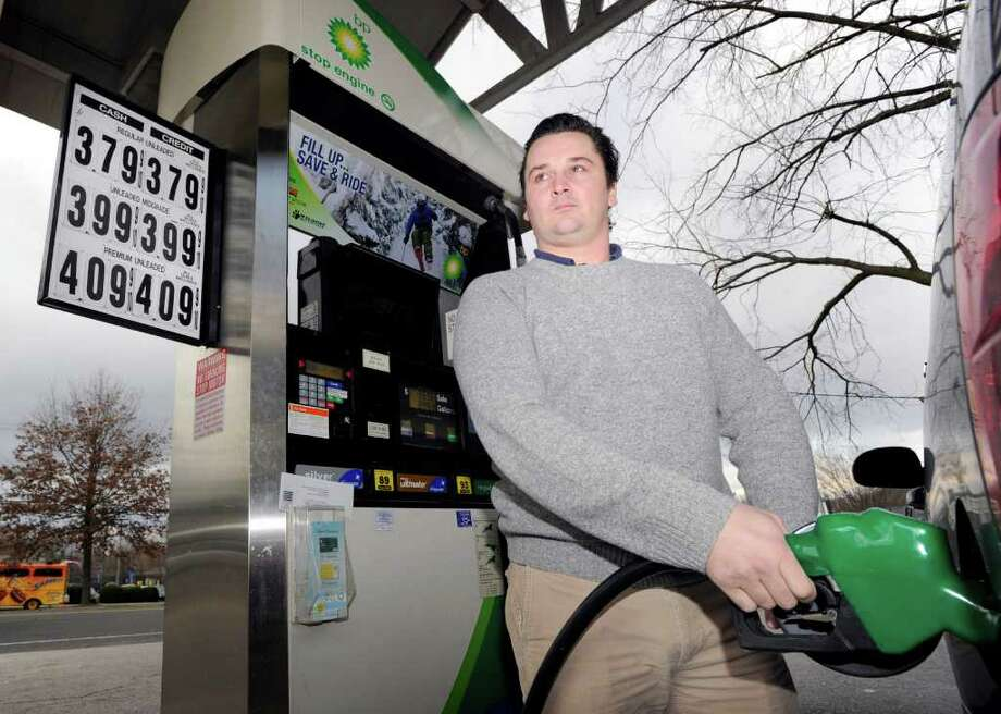 Peter Spiller of Cos Cob pumps gas at the BP station at 1324 E. Putnam Ave. in Old Greenwich Friday, Jan. 13, 2012. The price for premium gas at the station is $4.09. Photo: Bob Luckey / Greenwich Time