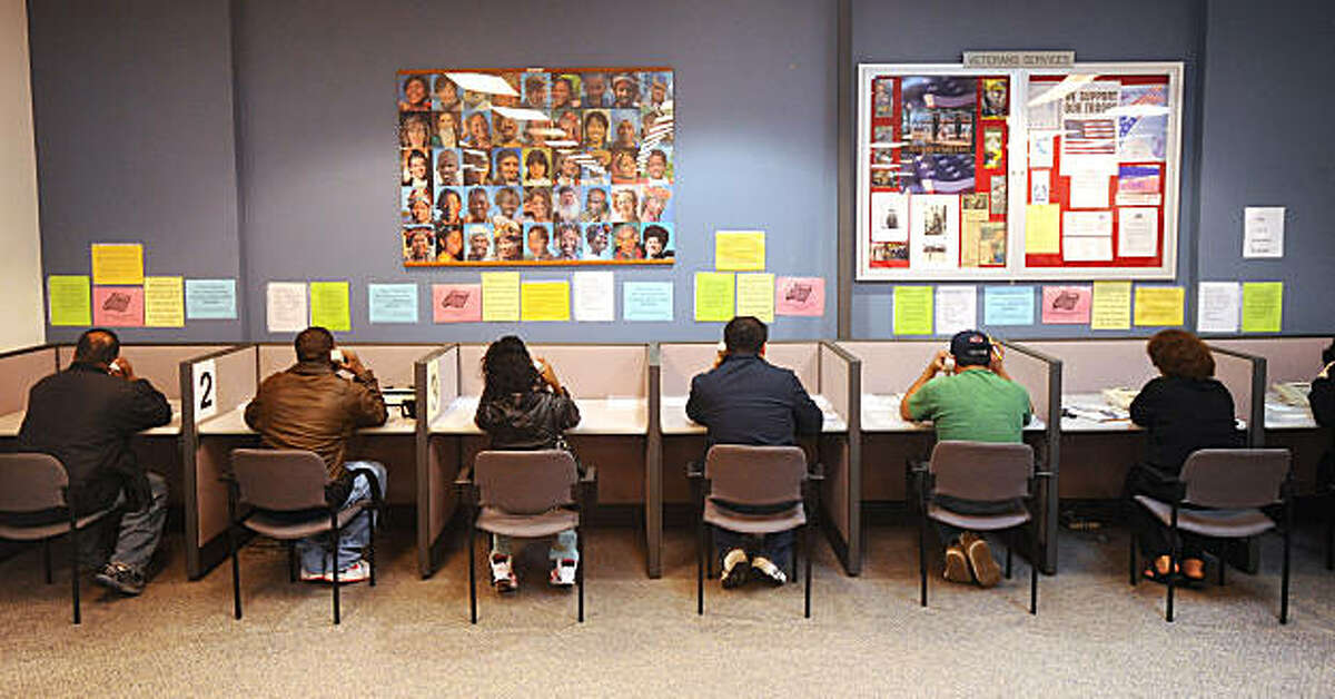 Unemployed workers use special phones in San Francisco's Employment Development Department office to resolve their claim status on Monday, March 1, 2010.