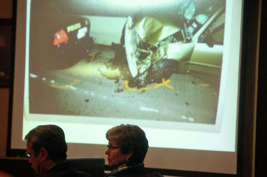 Sandra Briggs and her attorney, Edward Piker, watch as photographs are shown from the scene where SAPD Officer Sergio Antillon, 25, was hit by a car driven by Briggs. Photo: LISA KRANTZ, SAN ANTONIO EXPRESS-NEWS / SAN ANTONIO EXPRESS-NEWS