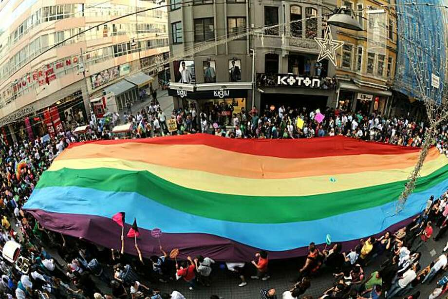 Turkish homosexuals and human rights activists chant slogans as they hold a giant rainbow flag during the Gay Pride Parade march on Istiklal Avenue in Istanbul, on June 27, 2010. Photo: Mustafa Ozer, AFP/Getty Images