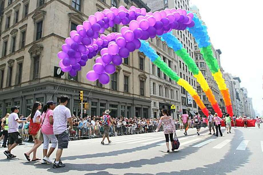 Strings of balloons are carried down New York's Fifth Avenue during the city's annual parade celebrating gay pride on Sunday, June 27, 2010 in New York. Photo: Tina Fineberg, AP