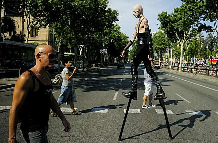 A participant walks at the end the gay and lesbian pride parade in the centre of Barcelona on June 27, 2010. Photo: Josep Lago, AFP/Getty Images