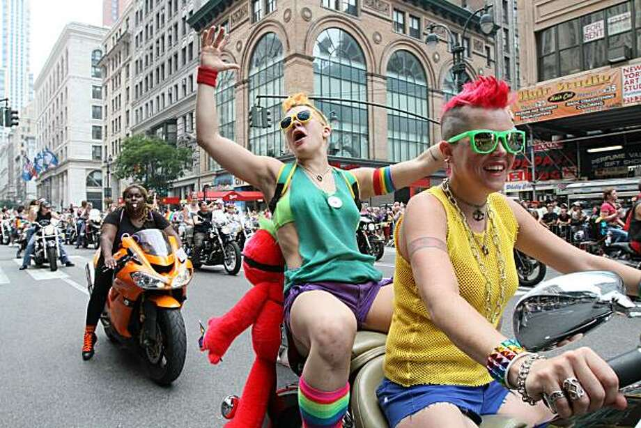 Jackie Carlson, second from right, and her partner Cara Lee Sparry, both from the Brooklyn borough of New York, make their way down New York's Fifth Avenue as they take part in the city's annual parade celebrating gay pride on Sunday, June 27, 2010. Photo: Tina Fineberg, AP