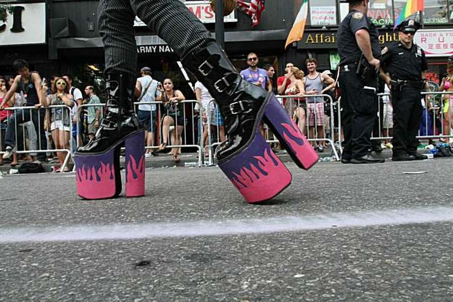 A man wearing platform shoes walks by as he takes part in the Gay Pride Parade Sunday June 27, 2010 in New York. Photo: Tina Fineberg, AP