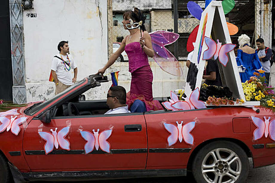 A transsexual performs on a car during the Gay Pride parade in Guatemala City, Saturday, June 26, 2010. Photo: Moises Castillo, AP
