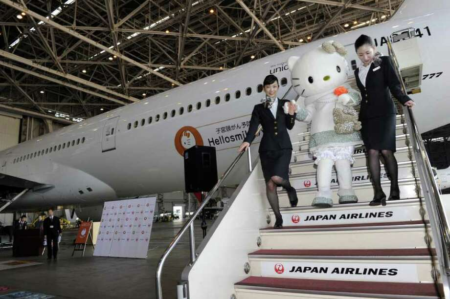 Japan Airlines unveiled a Hello Kitty-themed 'Hellosmile' Boeing 777-300 at Tokyo Haneda Airport on Friday, Jan. 13, 2012. JAL, TOKYO FM Broadcasting and Hello Kitty parent Sanrio Co. joined in the effort to promote cervical cancer awareness and prevention. The jet is scheduled to fly to such major domestic destinations as Sapporo, Osaka, Fukuoka and Okinawa for a year, starting Friday. Photo: YOSHIKAZU TSUNO, AFP/Getty Images / 2012 AFP