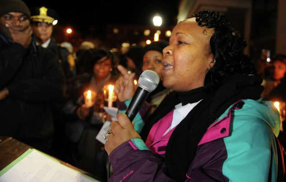 Dawn Spearman, founder of Y.A.N.A., You Are Not Alone, speaks to the crowd Wednesday, Jan. 11. 2012 during an anti-violence rally through Bridgeport, Conn.  Hundreds of residents marched from the East End Police Substation on Stratford Avenue to City Hall in response to the shooting of 14-year-old Justin Thompson. Photo: Autumn Driscoll / Connecticut Post