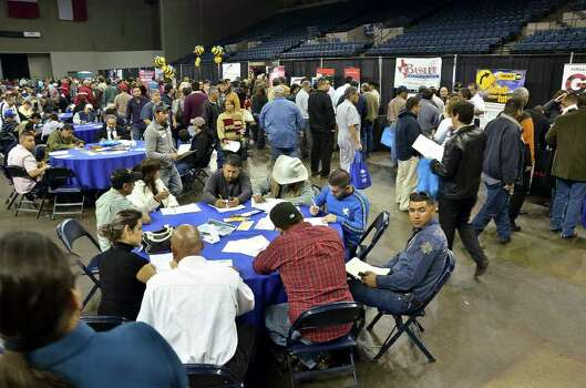 The Laredo Energy Arena was packed with job seekers at the Eagle Ford Shale Job Fair Friday. Photo: CUATE SANTOS / LAREDO MORNING TIMES