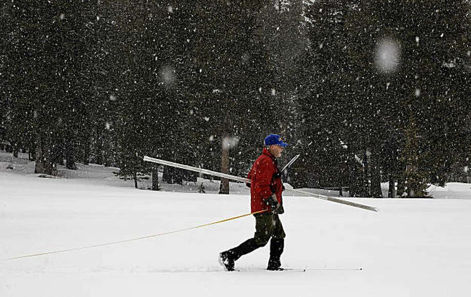 Frank Gehrke of the California Department of Water Resources conducts the first snow survey of the winter season at Phillips Station on Tuesday. Photo: Michael Macor, The Chronicle