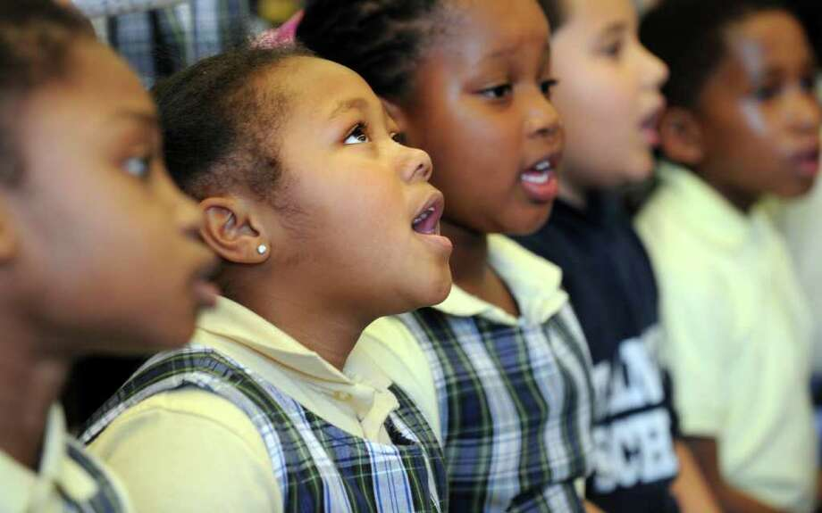 Second grade student Aniah Hines practices a musical selection with her class Friday, Jan. 13. 2012 at St. Andrew School in Bridgeport, Conn.  Second grade students were rehearsing for their tribute to Dr. Martin Luther King, Jr. where the children present facts about Dr. King's life and his mission. Photo: Autumn Driscoll / Connecticut Post