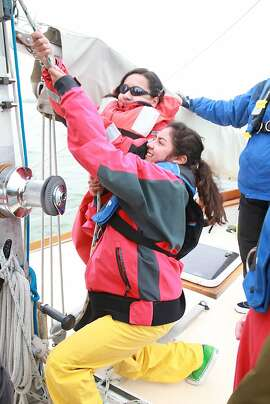 Students learn teamwork sailing out of Berkeley Marina in July 2011 as part of the Pegasus Project. Shown here: Alejandra Covarrubias and Emily Maciel.
