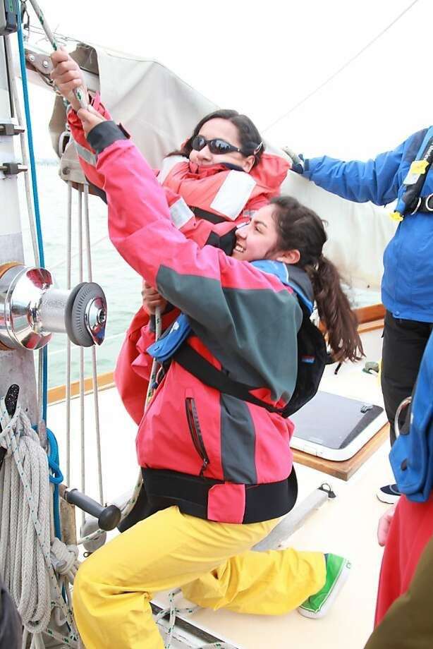 Students learn teamwork sailing out of Berkeley Marina in July 2011 as part of the Pegasus Project. Shown here: Alejandra Covarrubias and Emily Maciel. Photo: Richard Gillette