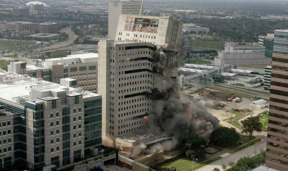 A building that once housed the regional headquarters for Prudential Insurance was imploded last Sunday. Photo: Nick De La Torre / © 2012  Houston Chronicle