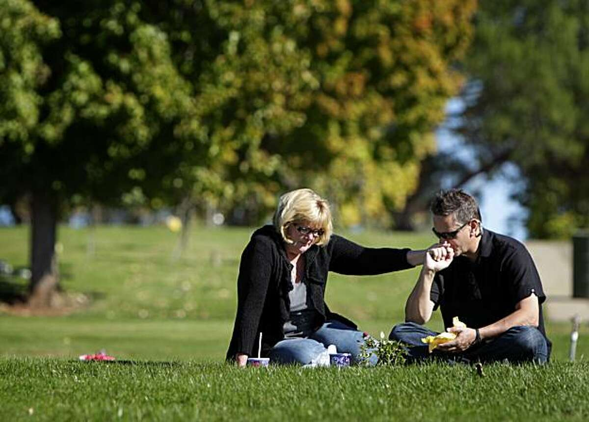 Kendall and Eric Butler take their son Justin Butler's favorite food from Taco Bell to his graveside for lunch at the New Auburn Cemetery, Monday Nov. 1, 2010, in Auburn, Calif. Justin, 16, died in September, 2010, possibly playing a self-asphyxiation game called