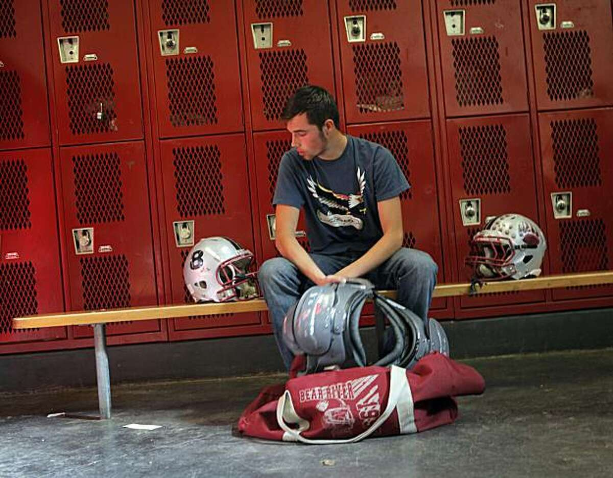 Michael Wirth, a senior and football player at Bear Valley High School in Auburn, Calif., gets his uniform ready to hand in for the year, Monday, Nov.15, 2010. To honor their friend Justin Butler, the entire football team had is number 8 displayed on their helmets for the reminder of the season after his death.