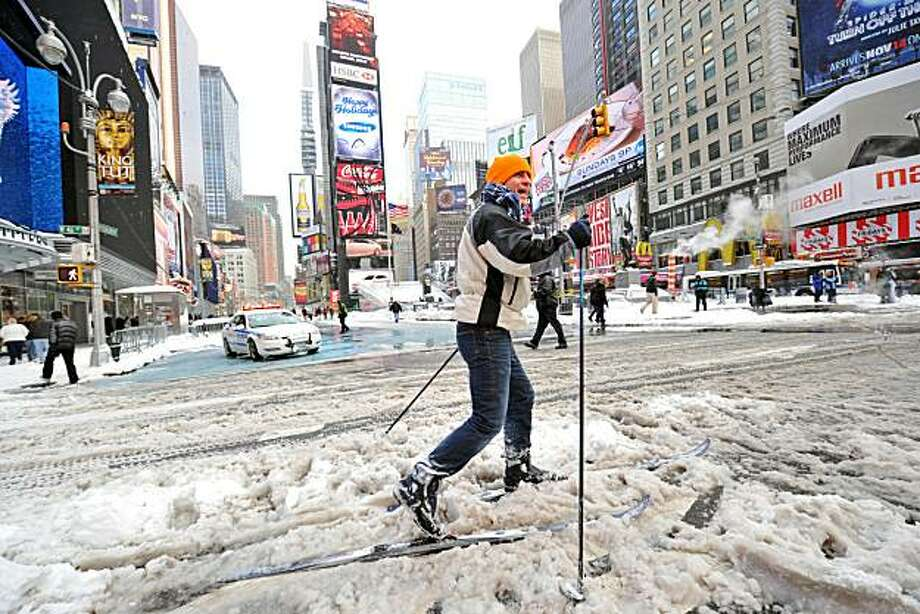 A man who gave his name as Marcus cross country skis through snow in New York's Times Square December 27, 2010 after a blizzard dropped 18 to 20 inches (46 to 51 cm) of snow in the area. The tail end of a powerful blizzard across the US north-east snarledplans for millions of holiday travelers Monday, forcing New York airport closures and crippling road and rail traffic. The New York area was especially hard hit. John F. Kennedy International Airport and La Guardia Airport, as well as Newark International in New Jersey, were closed Sunday and overnight and were not due to reopen until 4:00 pm (2100 GMT). Photo: Stan Honda, AFP/Getty Images