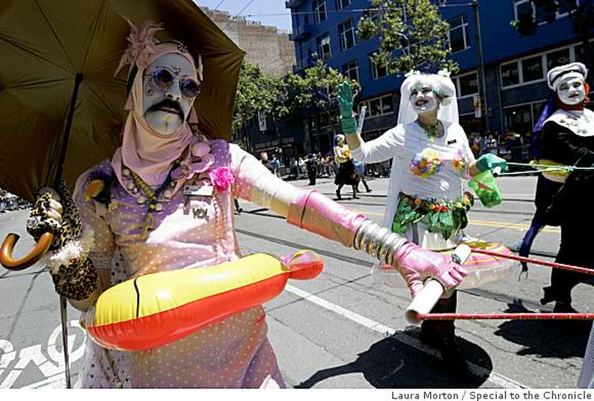 The Sisters of Perpetual Indulgence including Sister Mae JoyB WIthU (left) march down Market St. during the LGBT Pride Parade Sunday Morning in San Francisco, CA
