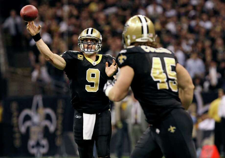 Quarterback Drew Brees, looking for Jed Collins against the Lions last week, and the Saints have gained at least 600 yards of offense in each of their past two games. Photo: AP