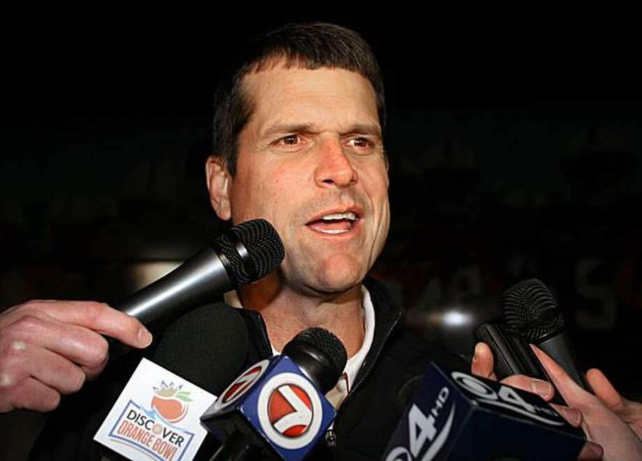 Stanford's head coach Jim Harbaugh arrives at Miami International Airport Monday Dec. 27, 2010. Stanford will face Virginia Tech in the Discover  Orange Bowl on Jan. 3, 2011. Photo: Jeffrey Boan, AP